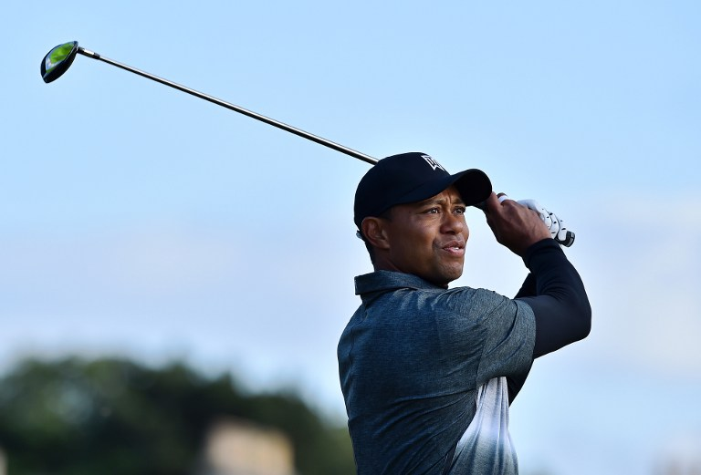 woods scores flawless seven