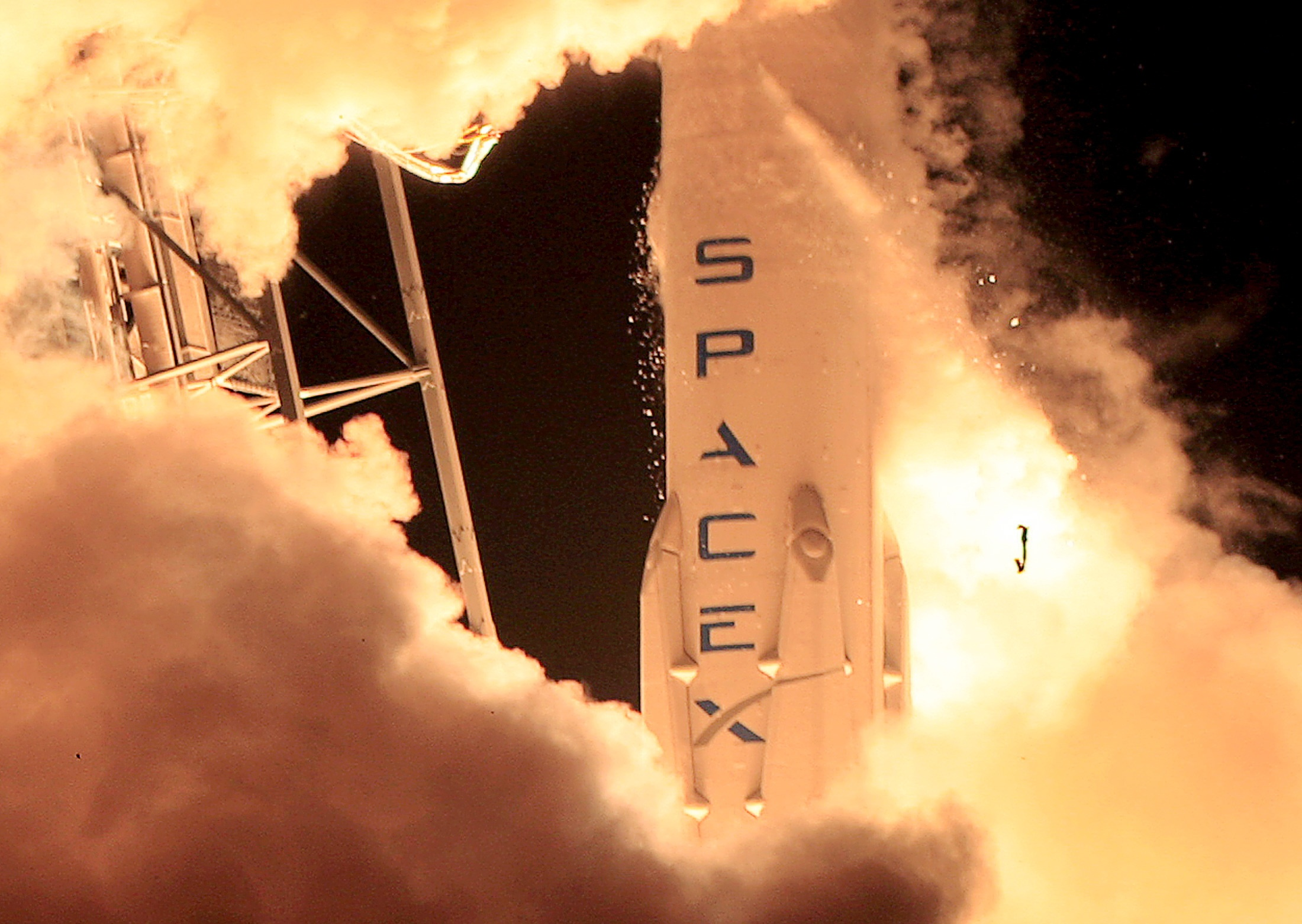 File: SpaceX makes most of its money from multibillion-dollar contracts with NASA and satellite launches.