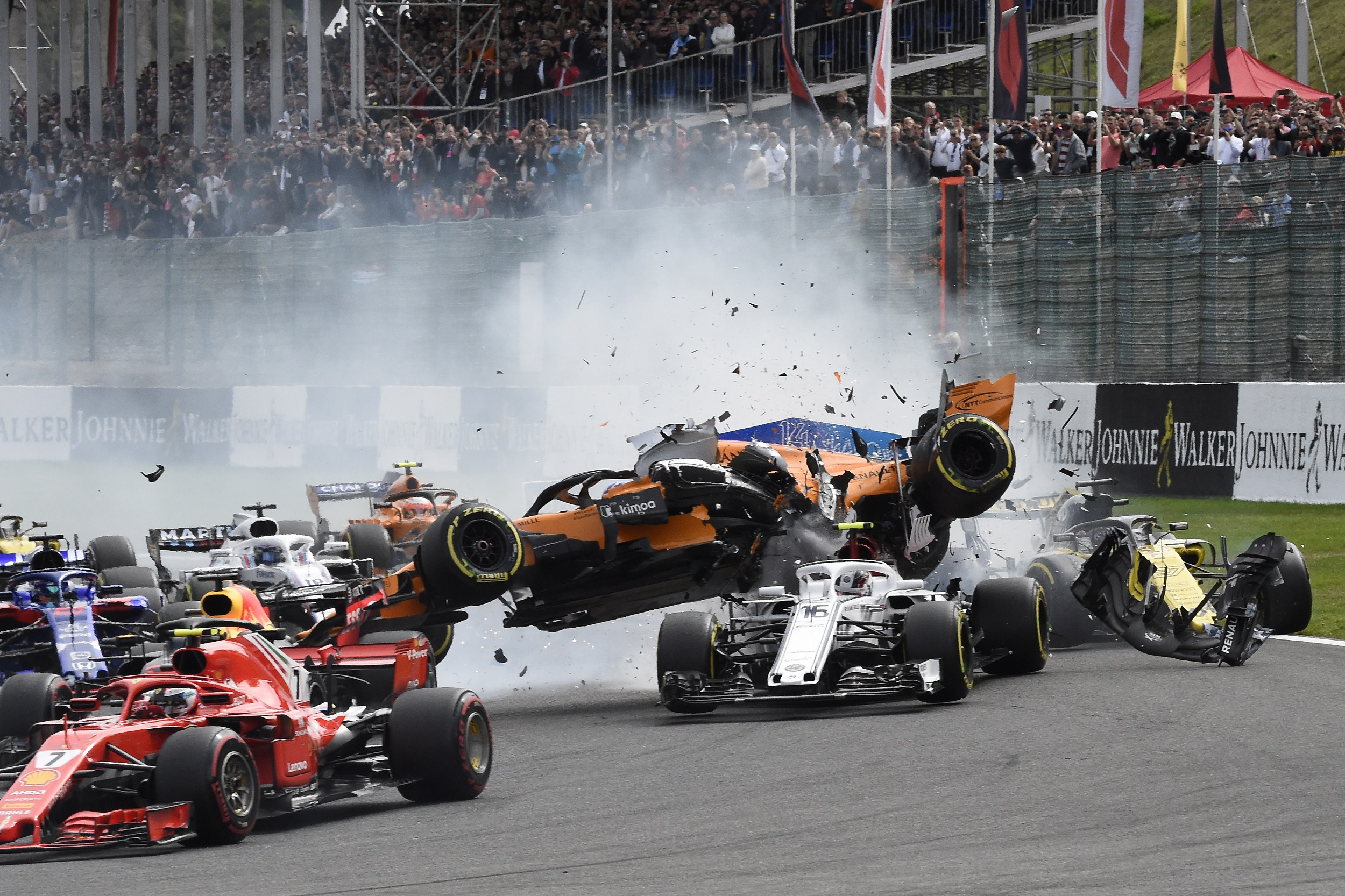 Fernando Alonso praises 'beautiful' halo after first corner crash at Spa