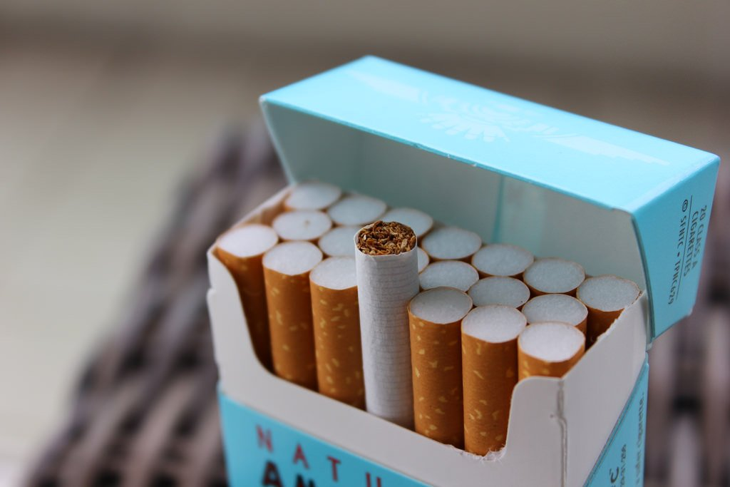 A file image of an open pack of cigarettes in a blue box.