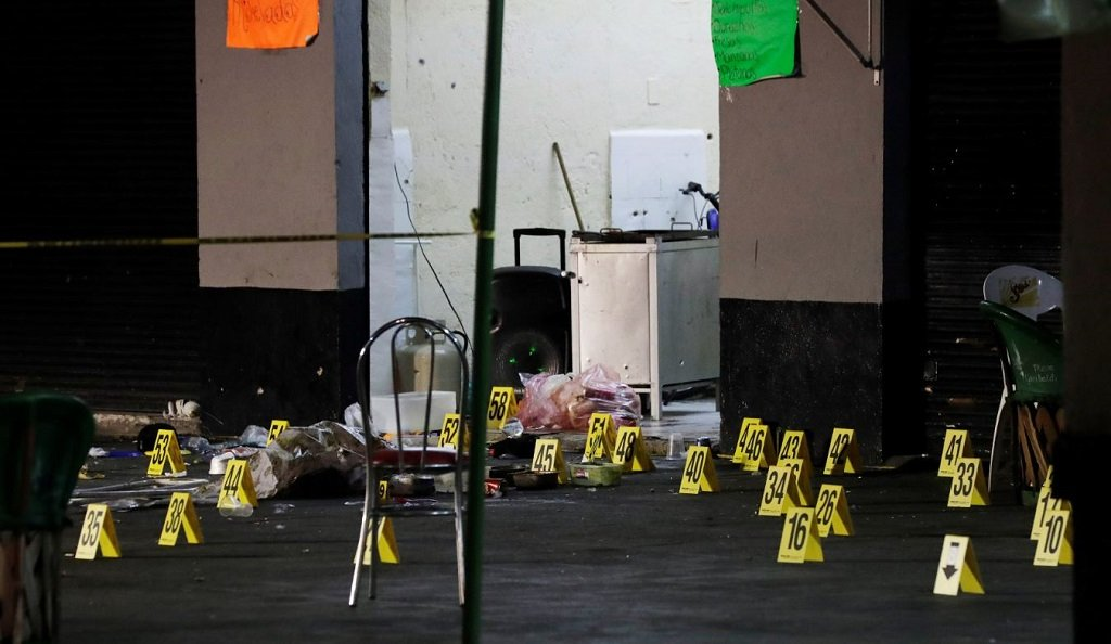 Evidence markers are seen at a crime scene where three men were gunned down by unknown assailants at an intersection on the edge of tourist Plaza Garibaldi in Mexico City Mexico