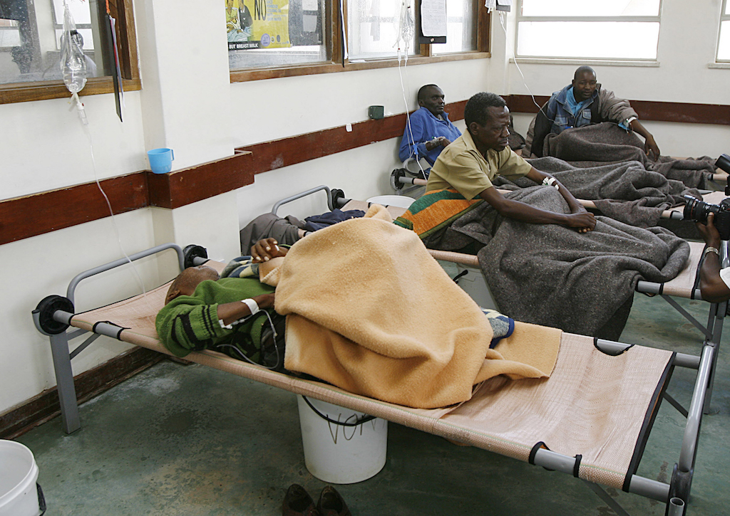 File: At least 20 people have died in Zimbabwe capital Harare and scores fallen ill after a cholera and typhoid outbreak in some areas.