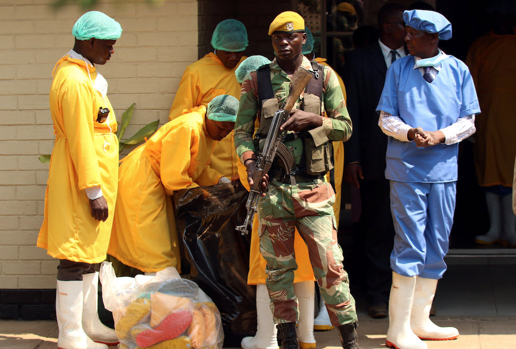 Soldiers stand guard as President Emmerson Mnangagwa visits cholera-affected patients in Harare.