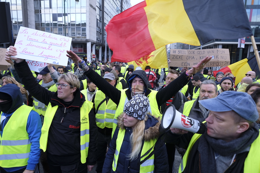 People wearing yellow vests take part in a protest against the rising of the fuel and oil prices in Brussels.