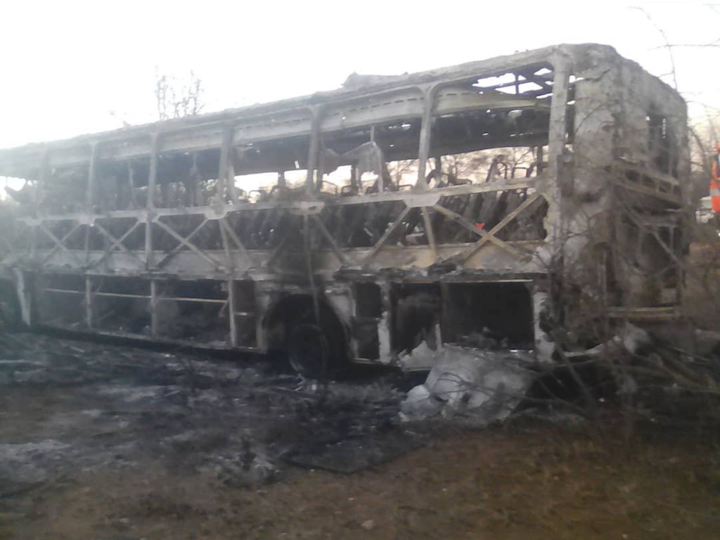 The burnt-out remains of a passenger bus that caught fire are seen near Beitbridge,Zimbabwe.