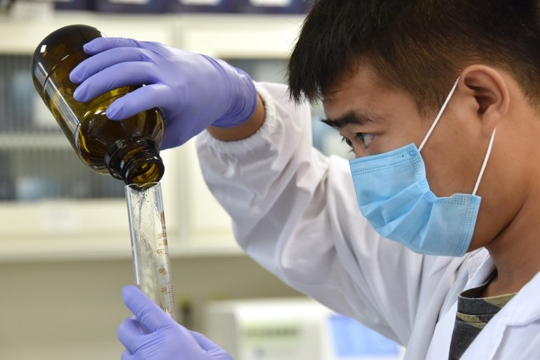 A technician works in a lab at GeseDNA Technology in Beijing