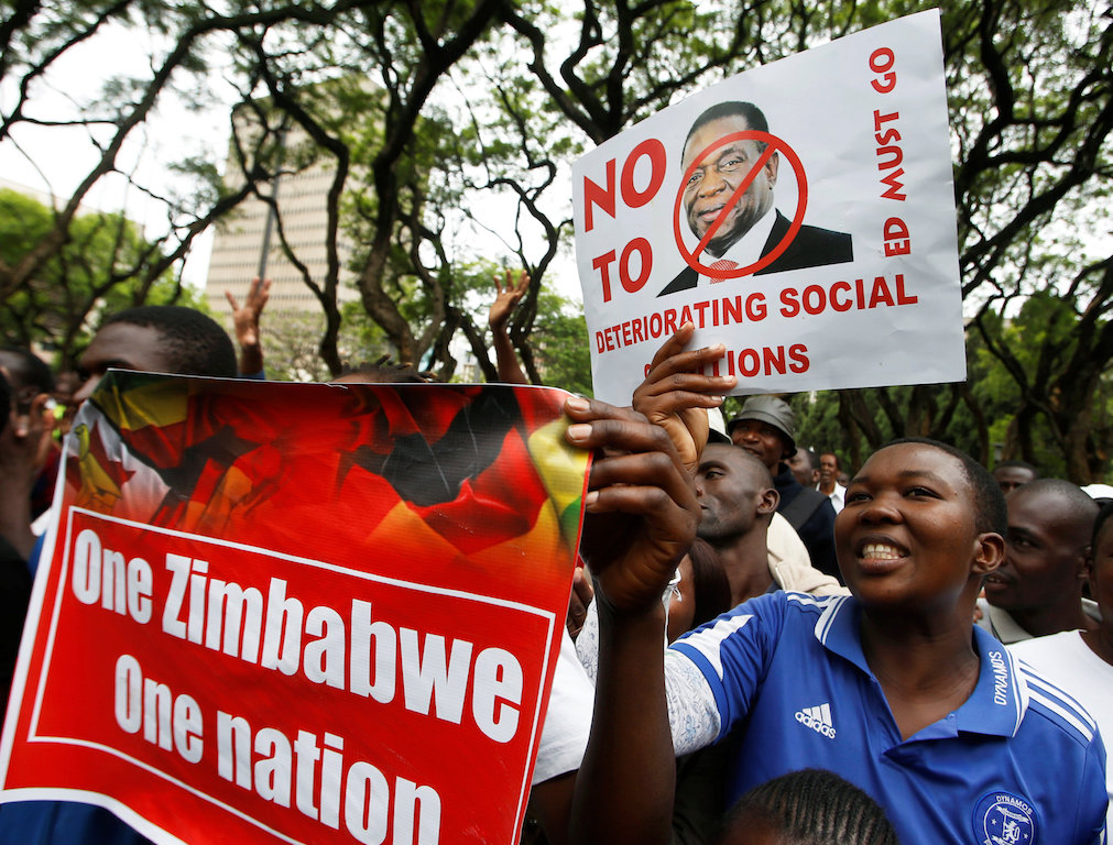 Supporters of the opposition Movement For Democratic Change (MDC) party take part in anti-government protests over economic hardships in Harare.