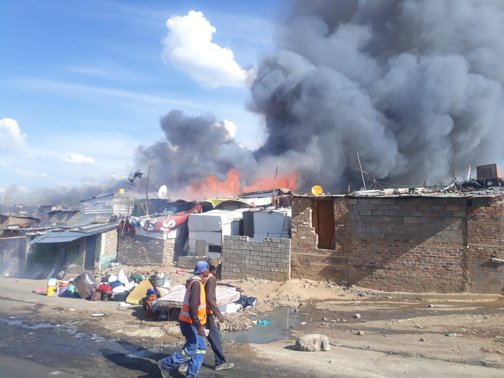 Residents of Alexandra say the blaze was started as part of a revenge attack where two men set alight a shack of another man.