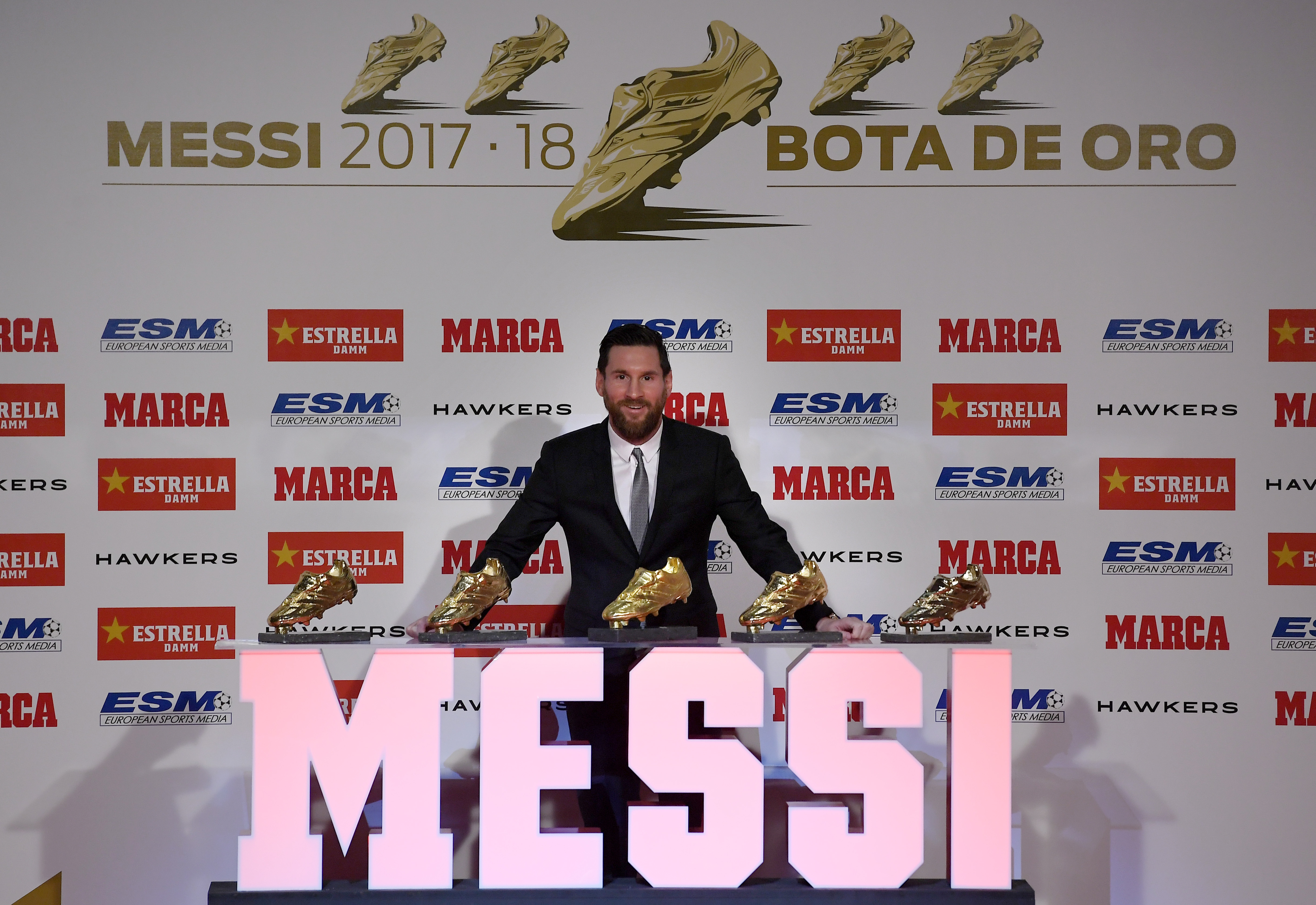 Barcelona's Argentinian forward Lionel Messi poses with the 2018 European Golden Shoe honoring the year's leading goalscorer and his other four trophies during a ceremony at the Antigua Fabrica Estrella Damm in Barcelona on December 18, 2018.
