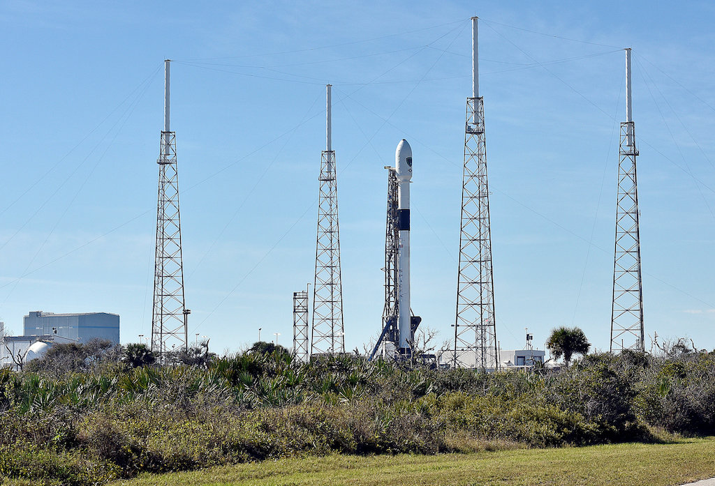 The SpaceX Falcon 9 rocket, scheduled to launch a US Air Force navigation satellite, sits on Launch Complex 40 after the launch was postponed after an abort procedure was triggered by the onboard flight computer.