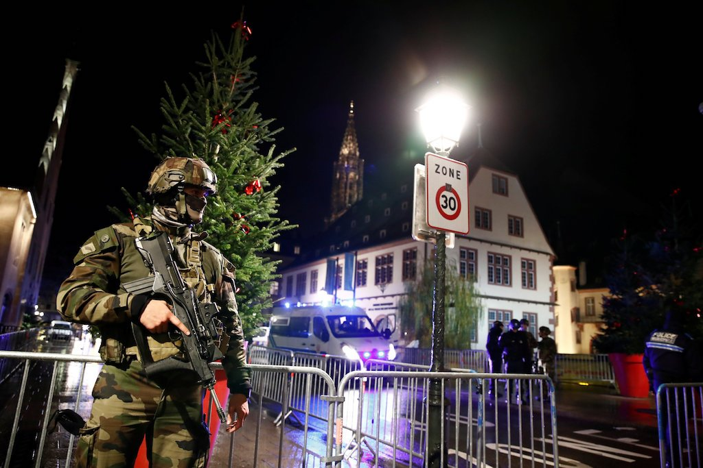 A soldier secures an area where a suspect is sought after a shooting in Strasbourg, France.