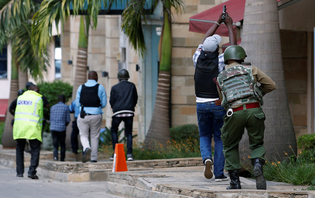 Members of security forces are seen at the scene where explosions and gunshots were heard at the Dusit hotel compound, in Nairobi, Kenya 15 January 2019.
