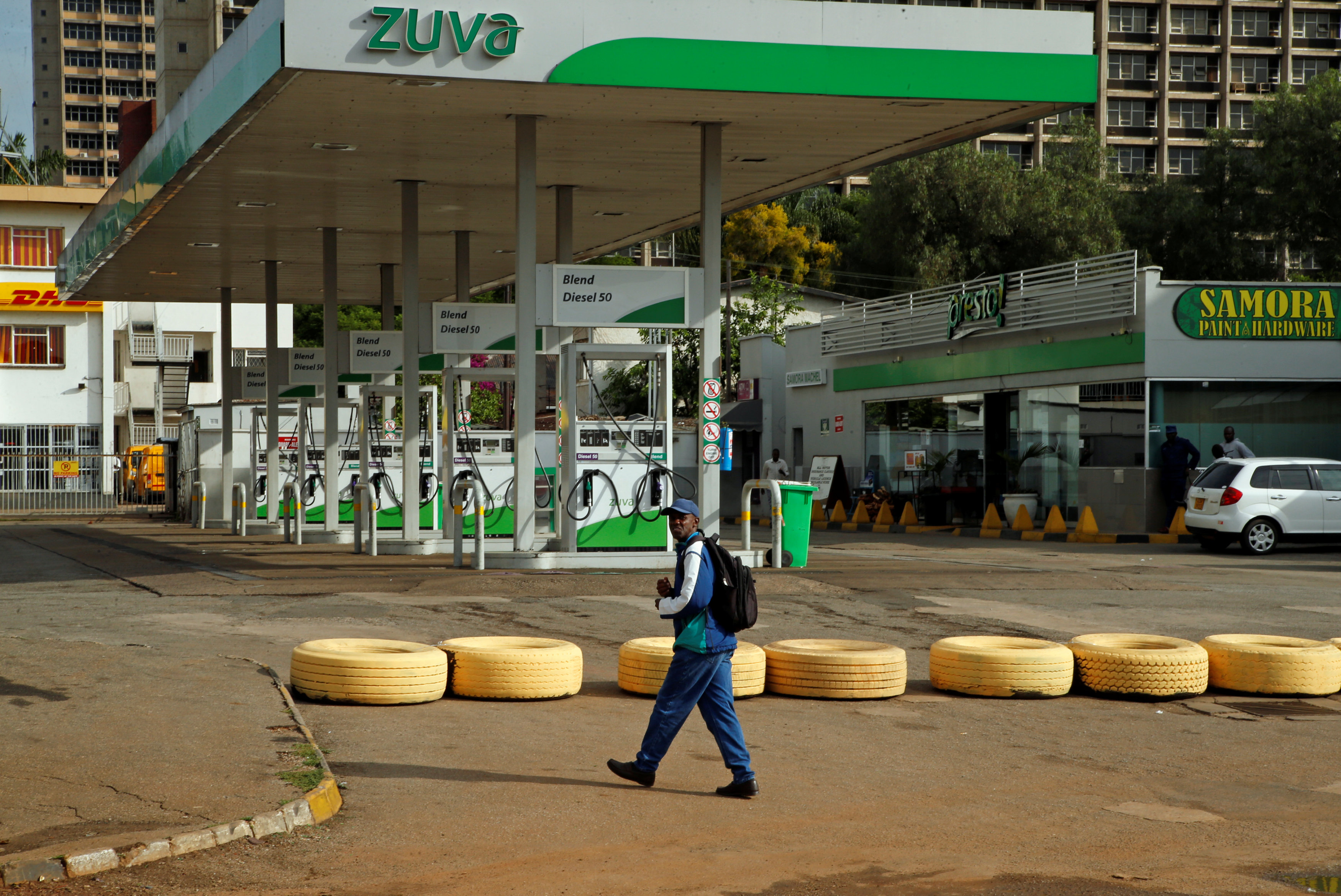 A man walks past a closed petrol station in Harare, Zimbabwe, January 16, 2019.