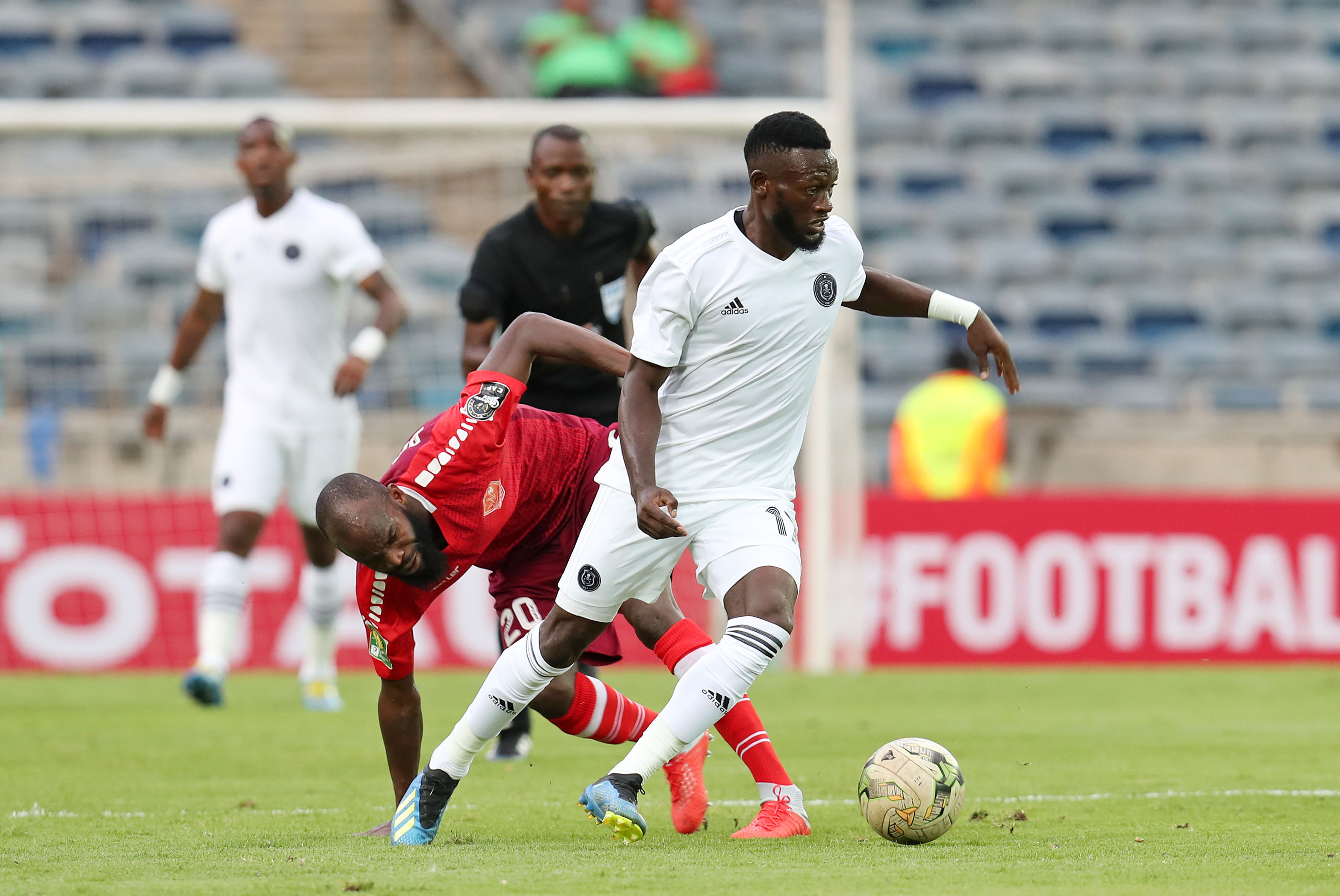 Bolaji Sakin of Horoya challenged by Augustine Mulenga of Orlando Pirates during the 2019 TOTAL CAF Champions League match at the Orlando Stadium, Soweto on the 18 January 2019.
