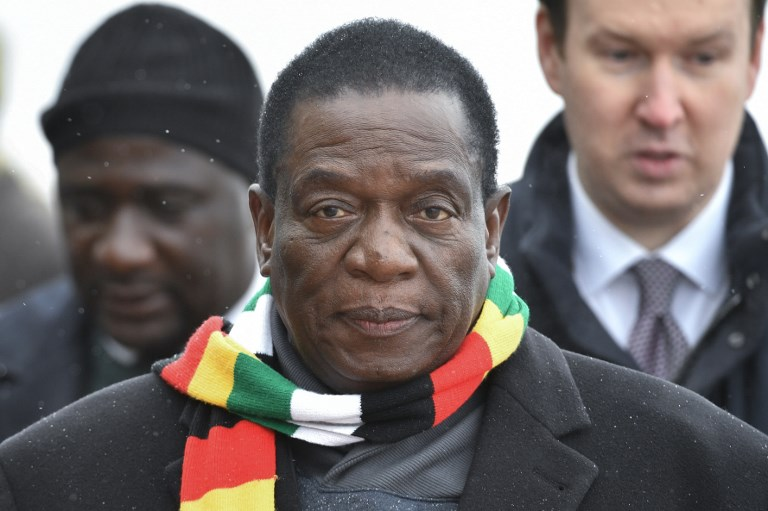 Zimbabwean President Emmerson Mnangagwa inspects Russian honour guards during a welcoming ceremony upon his arrival at Moscow's Vnukovo airport on January 14, 2019.