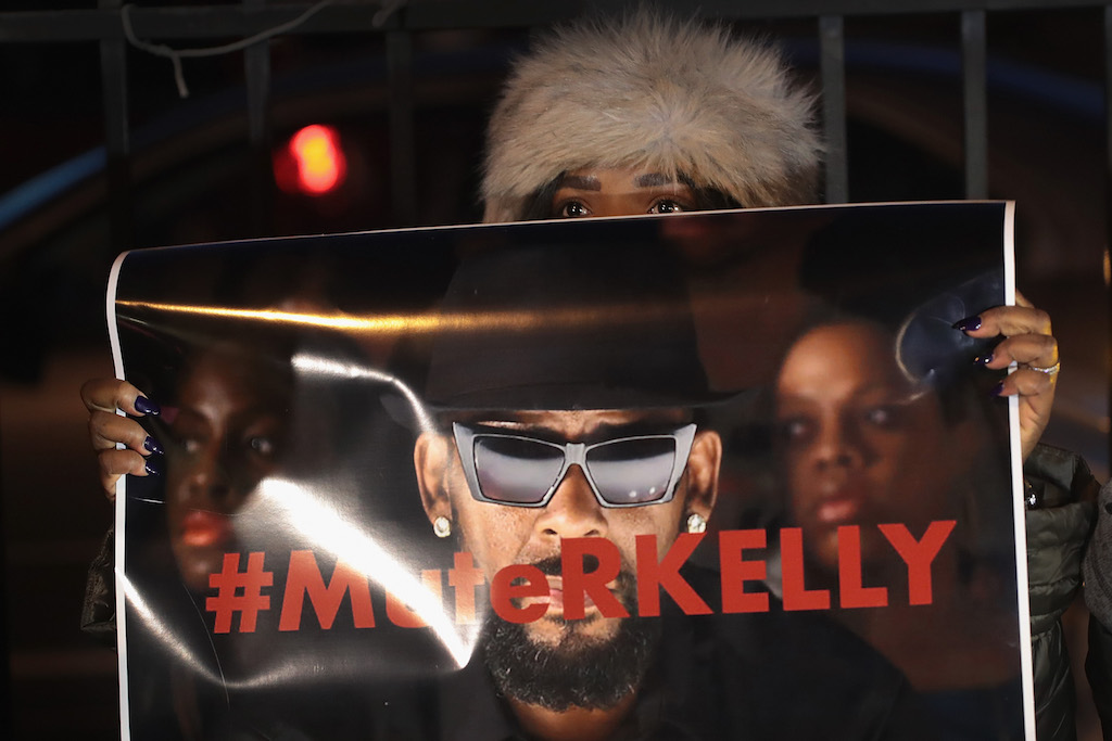 Demonstrators gather near the studio of singer R. Kelly to call for a boycott of his music.