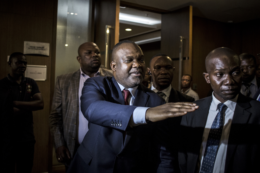 President of the National Independent Electoral Commission (CENI) Corneille Nangaa (C), gestures as he leaves a joint meeting with the main presidential candidates and the African Union (AU) in Kinshasa.
