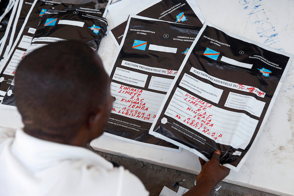 A man re-classifies voting materials at Congo's Independent National Electoral Commission (CENI) tallying centre in Kinshasa.