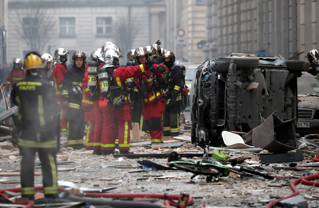 Firemen work at the site of an explosion in a bakery shop in the 9th District in Paris, France.