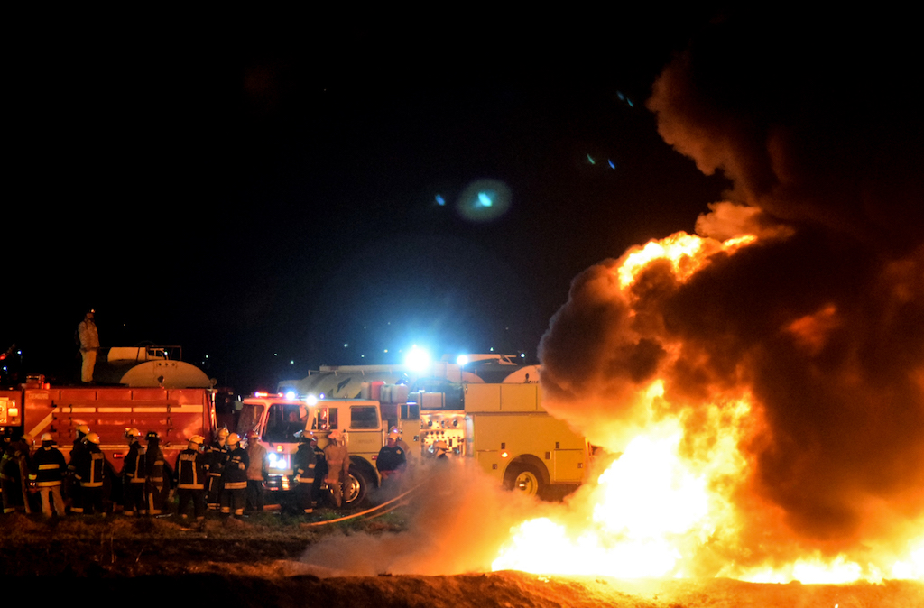Firefighters at the scene of a massive blaze triggered by a leaky pipeline in Tlahuelilpan, Hidalgo state.