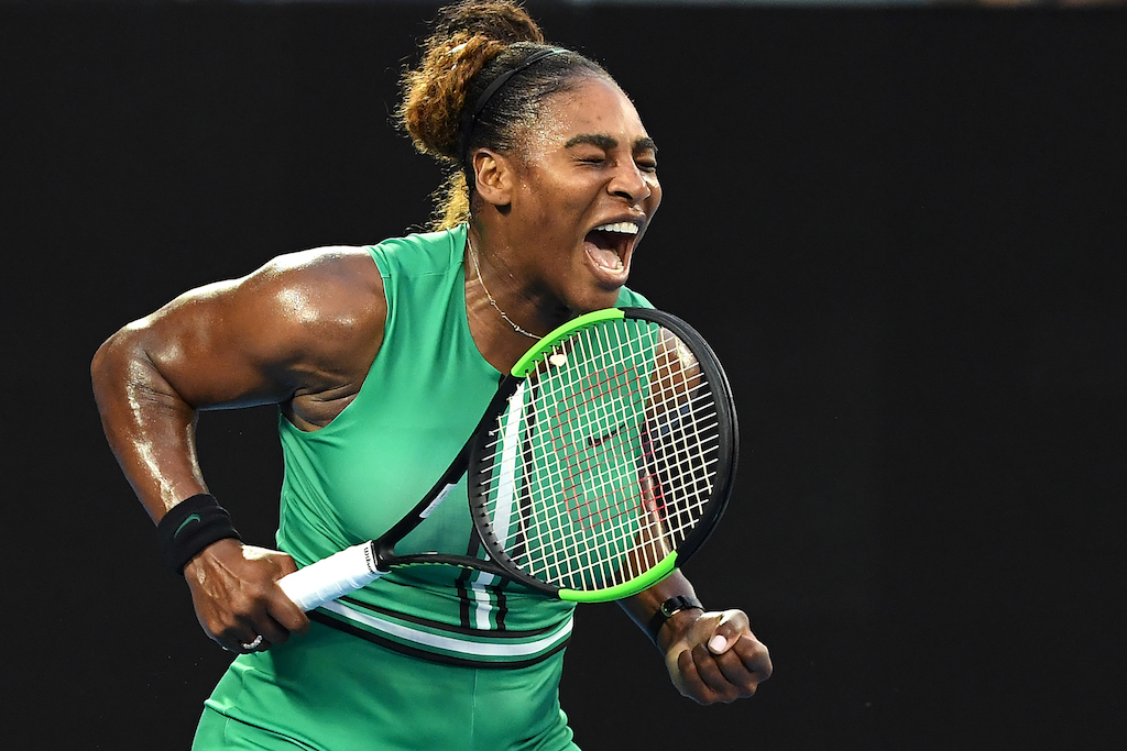 Serena Williams of the US reacts after a point against Romania's Simona Halep during their women's singles match on day eight of the Australian Open.