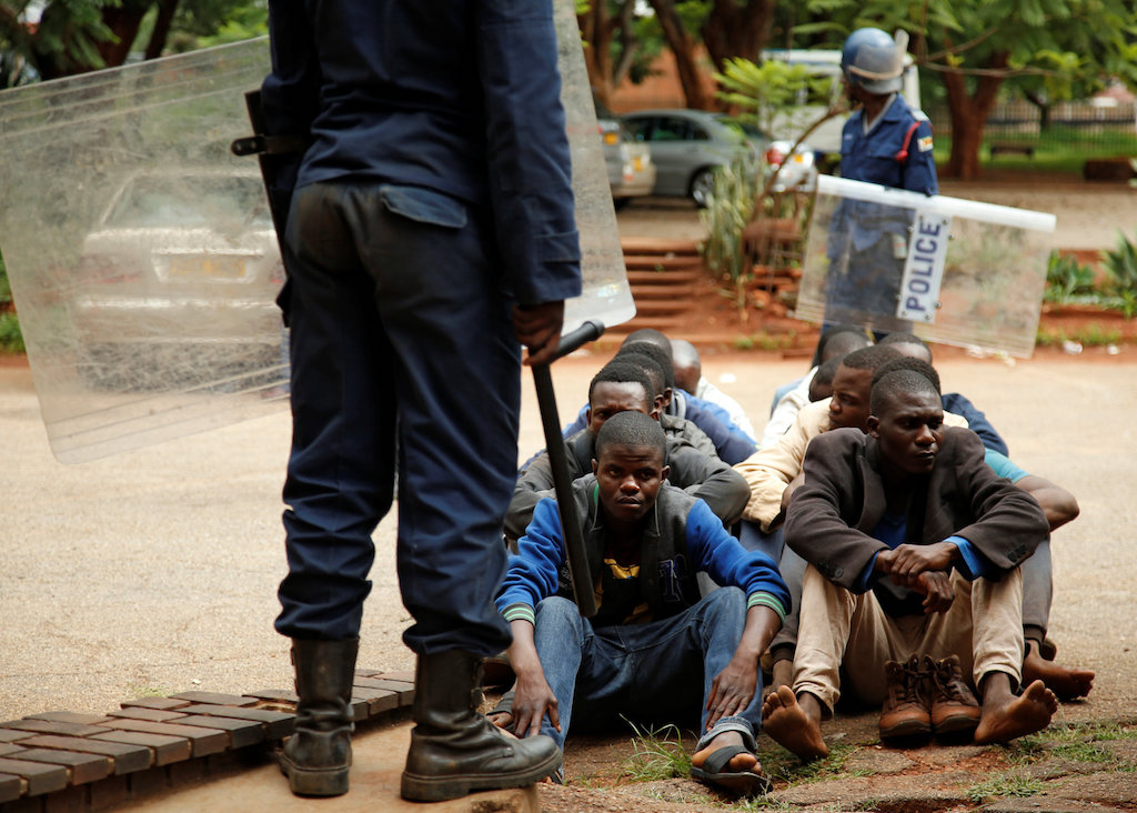 People arrested during protests wait to appear in the magistrate's court in Harare, Zimbabwe.