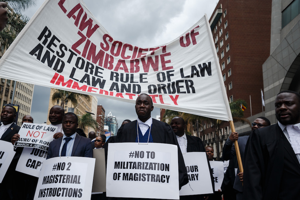 "Lawyers of the Law Society of Zimbabwe bar association take part in a ""March for Justice"" toward the Constitutional Court in Harare."