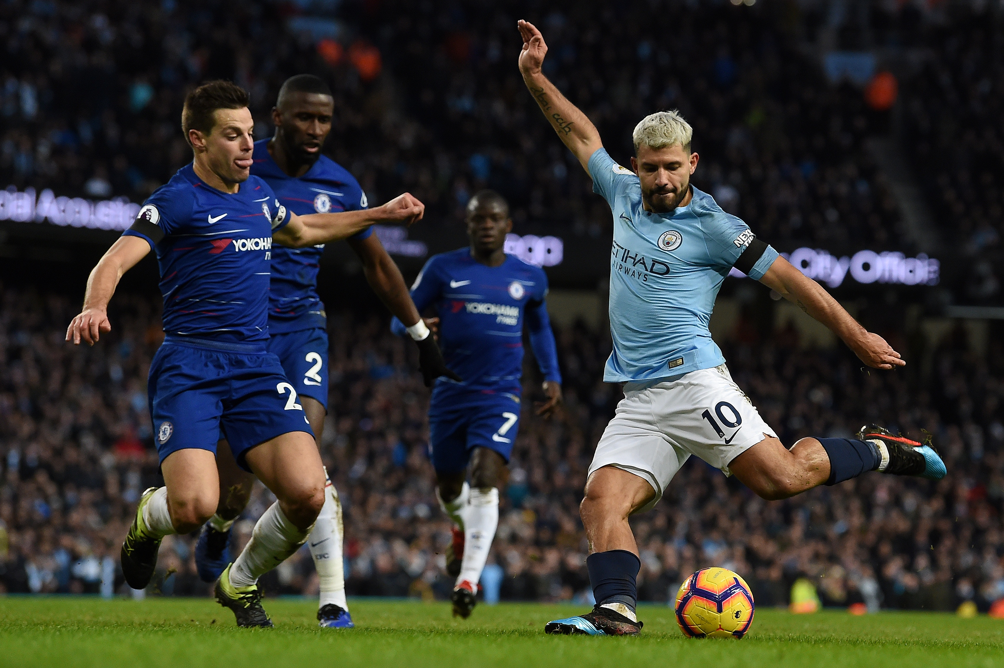 Manchester City's Argentinian striker Sergio Aguero (R) shoots but fails to score during the English Premier League football match between Manchester City and Chelsea at the Etihad Stadium in Manchester, northwest England, on February 10, 2019.