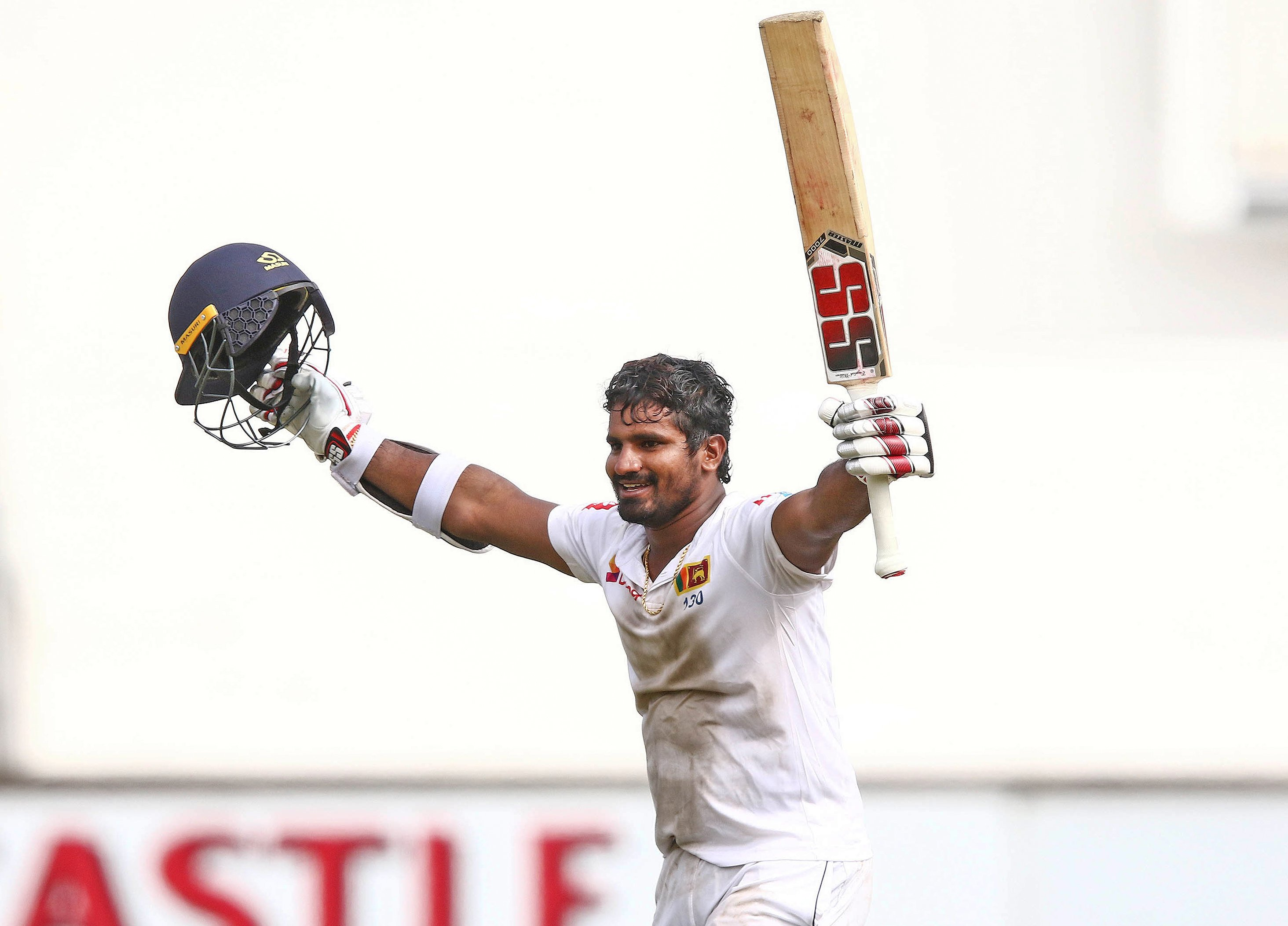 Sri Lanka's Kusal Perera celebrates the victory after hittting the winning runs during the fourth day of the first Cricket Test between South Africa and Sri Lanka at the Kingsmead Stadium in Durban on February 16, 2019.