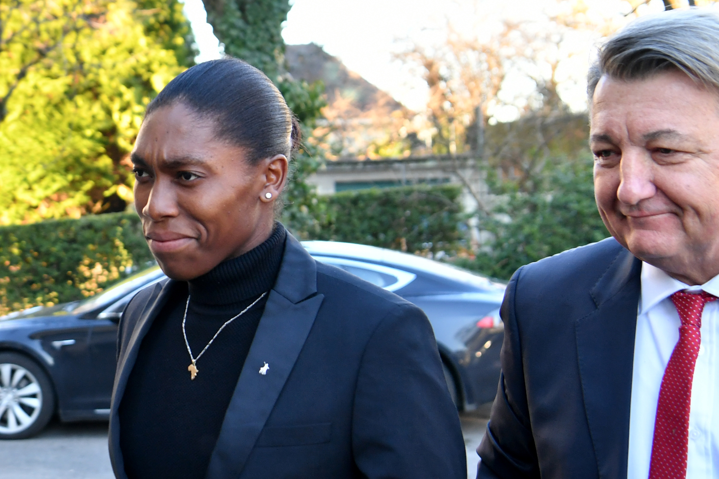 South African 800 meters Olympic champion Caster Semenya (L) and her lawyer Gregory Nott (R) arrive for a landmark hearing at the Court of Arbitration for Sport (CAS) in Lausanne on February 18, 2019.