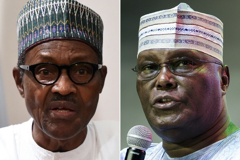 Nigerian President Muhammadu Buhari (L) speaking during a joint press conference in Abuja on August 31, 2018 and former vice-President Atiku Abubakar (R).
