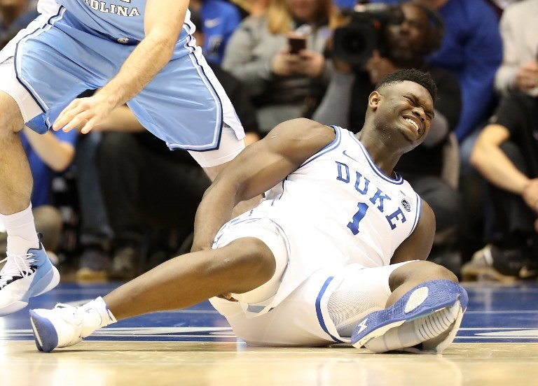 af8b5ce5da83 Zion Williamson  1 of the Duke Blue Devils reacts after falling as his shoe  breaks