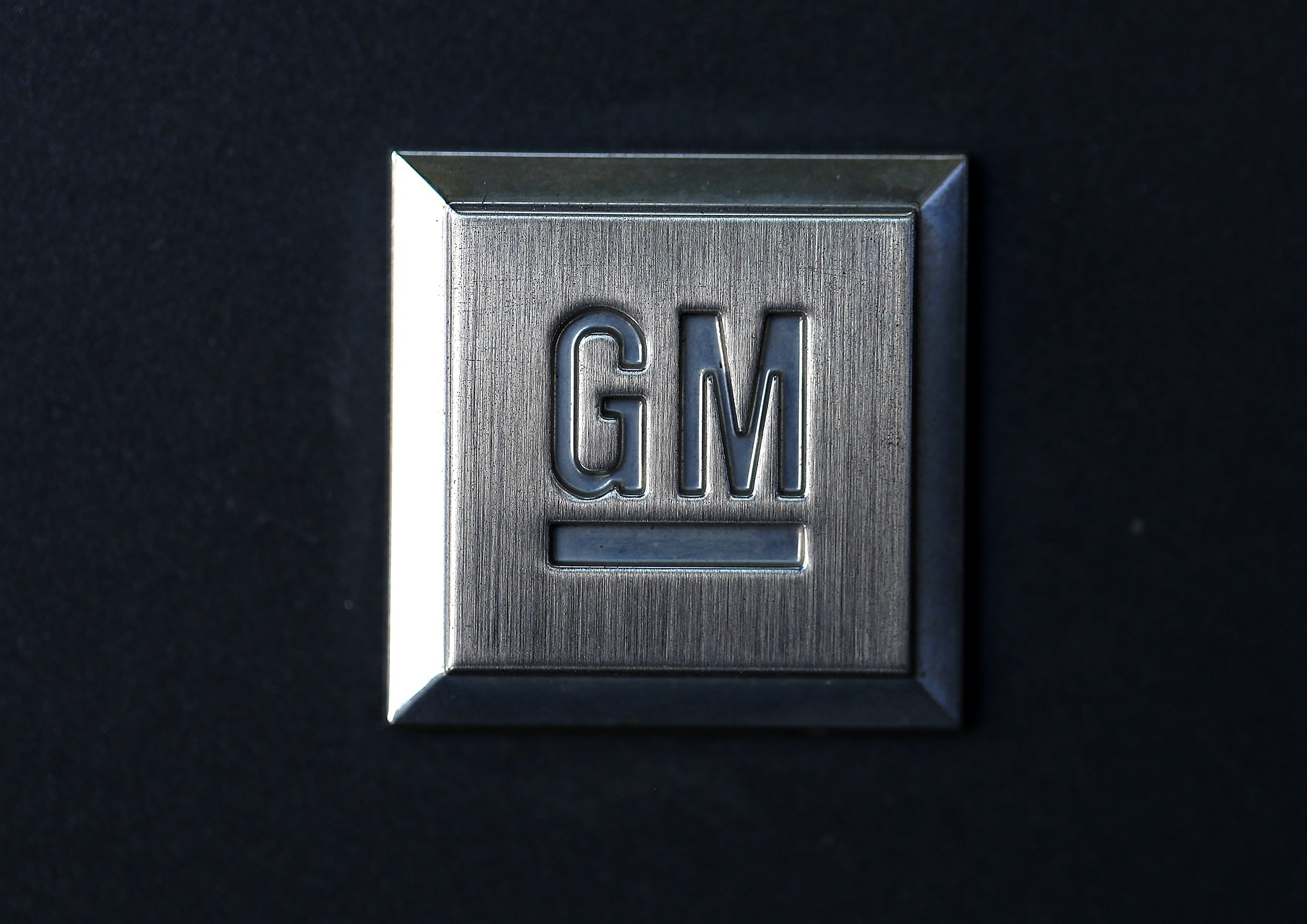 File: Car sales also declined in the United States, although the impact was mitigated by gains in GM's full-size pickups. ​​​​​​​