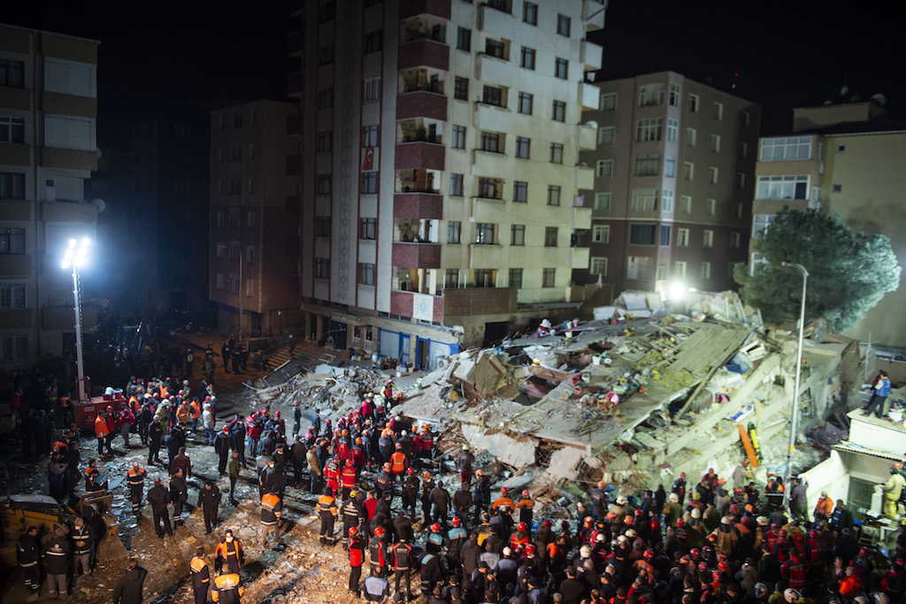 Rescuers work at the site of a collapsed building in Kartal district of Istanbul, Turkey.
