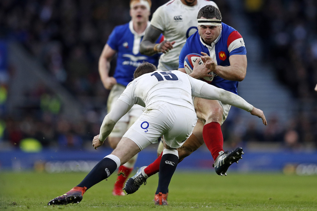 France's hooker Guilhem Guirado is tackled by England's full-back Elliot Daly during the Six Nations international rugby union match.