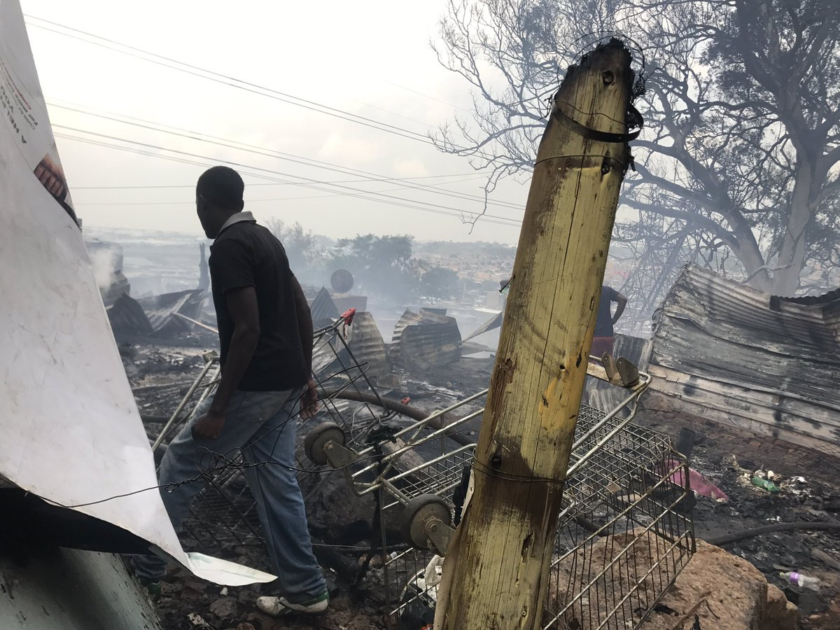Residents in Alexandra township are trying to salvage what they can after several shacks caught fire.