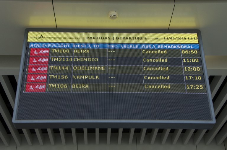 A Departures electronic panel indicating that all flights are cancelled is seen on March 14, 2019 at the Maputo International Airport in Mozambique.