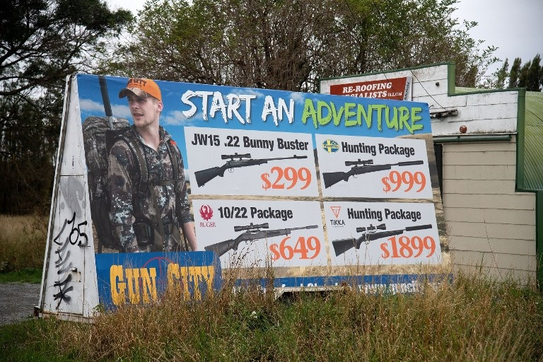 An advertisement for the Gun City store that has reportedly upset locals is seen on the outskirts of Christchurch on March 18, 2019.