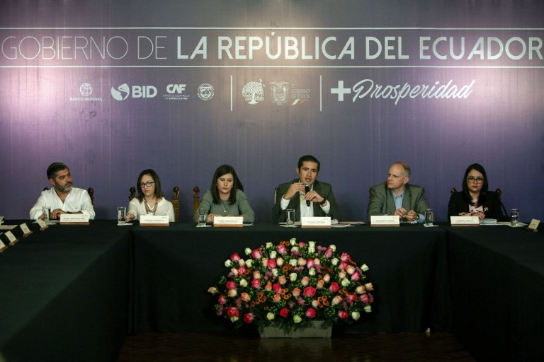 Ecuador's Economy Minister Richard Martinez (C) offers a press conference, along with other government representatives.