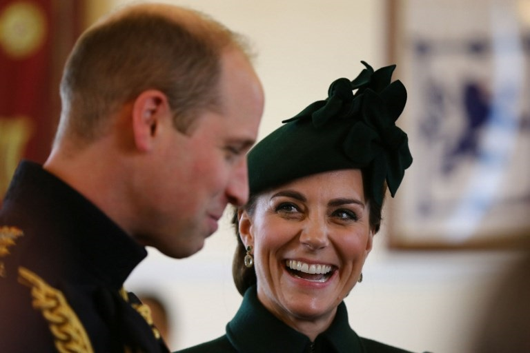 Britain's Prince William, Duke of Cambridge and Britain's Catherine, Duchess of Cambridge gesture as they meet unseen family members of the officers and guardsmen of the 1st Battalion Irish Guards.