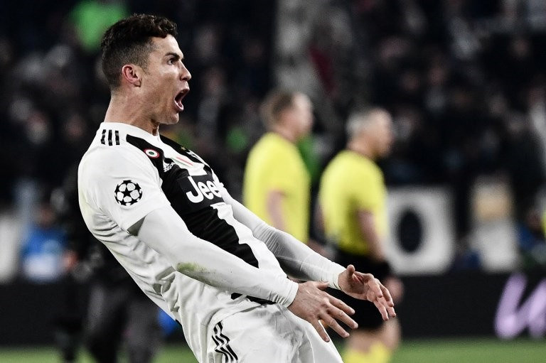 Juventus' Portuguese forward Cristiano Ronaldo celebrates after scoring 3-0 during the UEFA Champions League round of 16 second-leg football match Juventus vs Atletico Madrid.