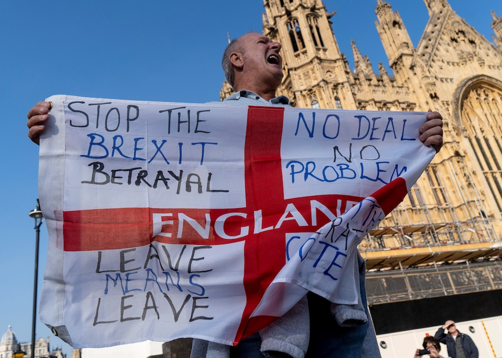 Pro-Brexit activists demonstrate near the Houses of Parliament in central London.