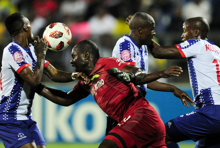 Denis Onyango of Mamelodi Sundowns FC takes on the defence of Yannick Zakri, Mxolisi Kunene and Evans Rusike of Maritzburg United.