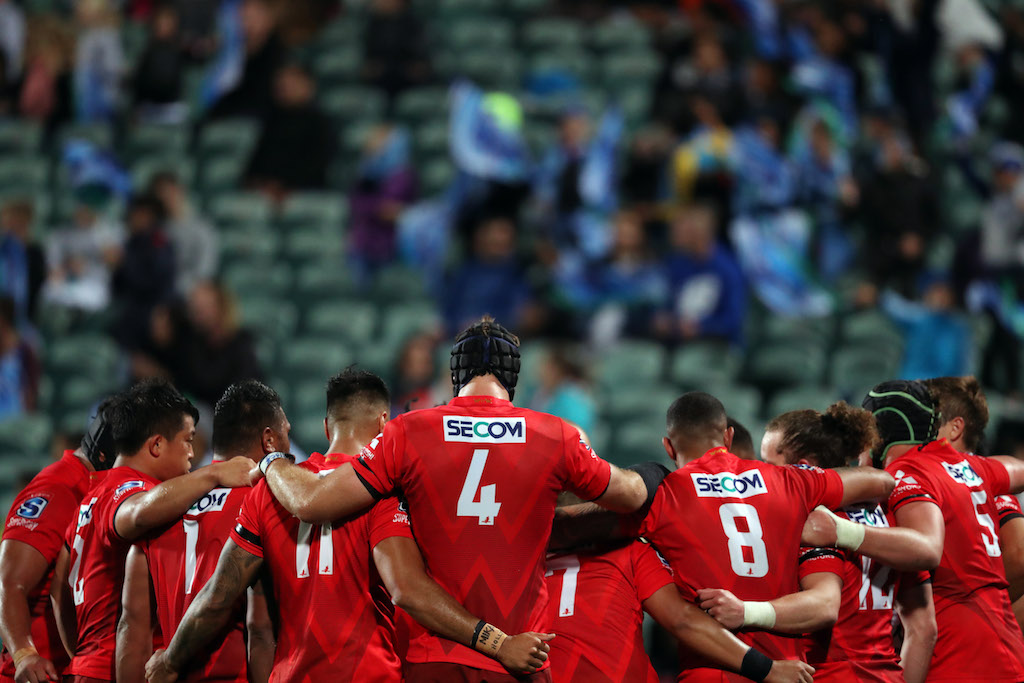 Sunwolves players come together for a team huddle during the Super Rugby match against New Zealand's Blues.