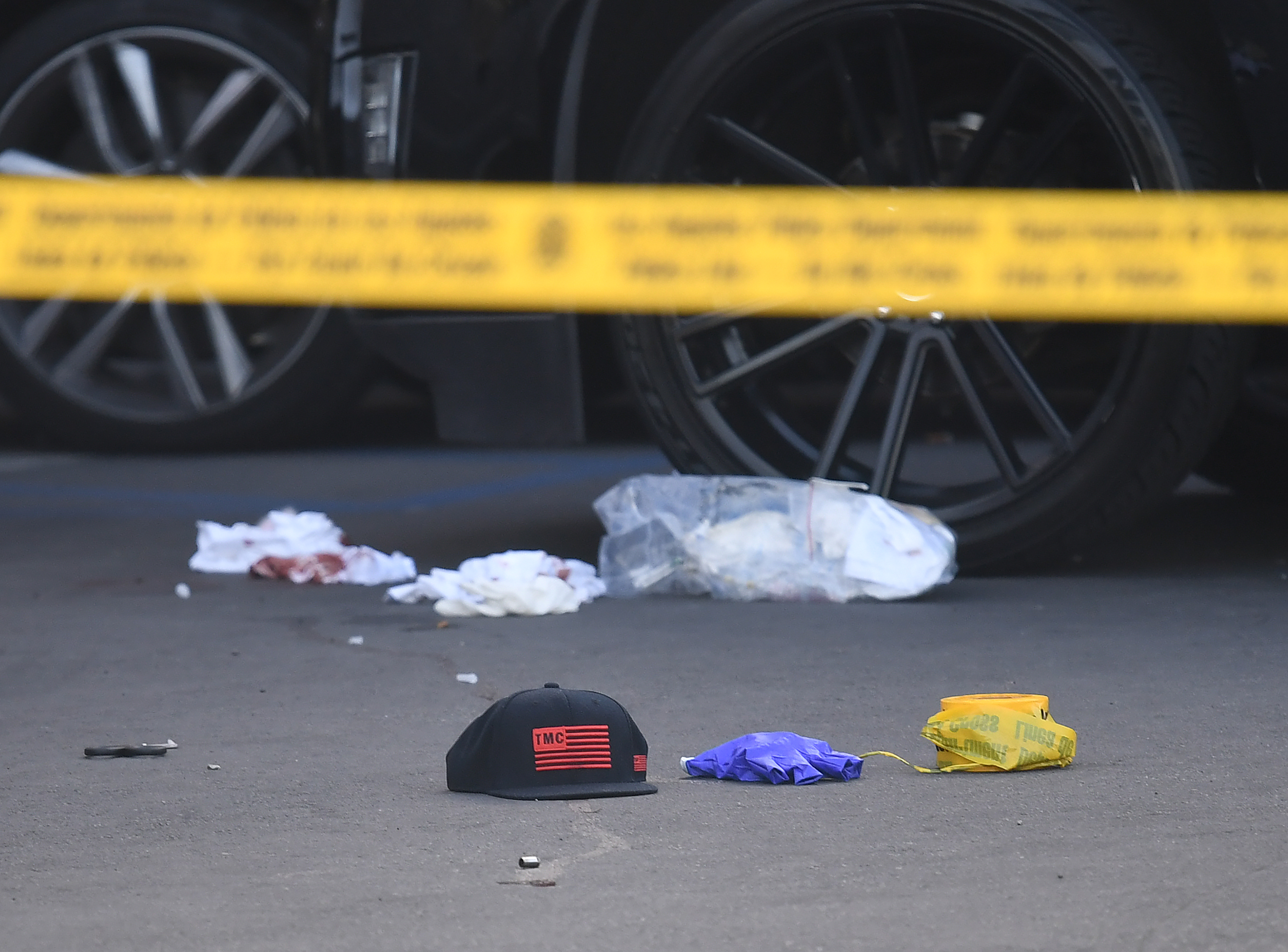 b12ed2d445d8ae Blood stained bandages and bullet casing on the ground outside The Marathon  clothing store owned by