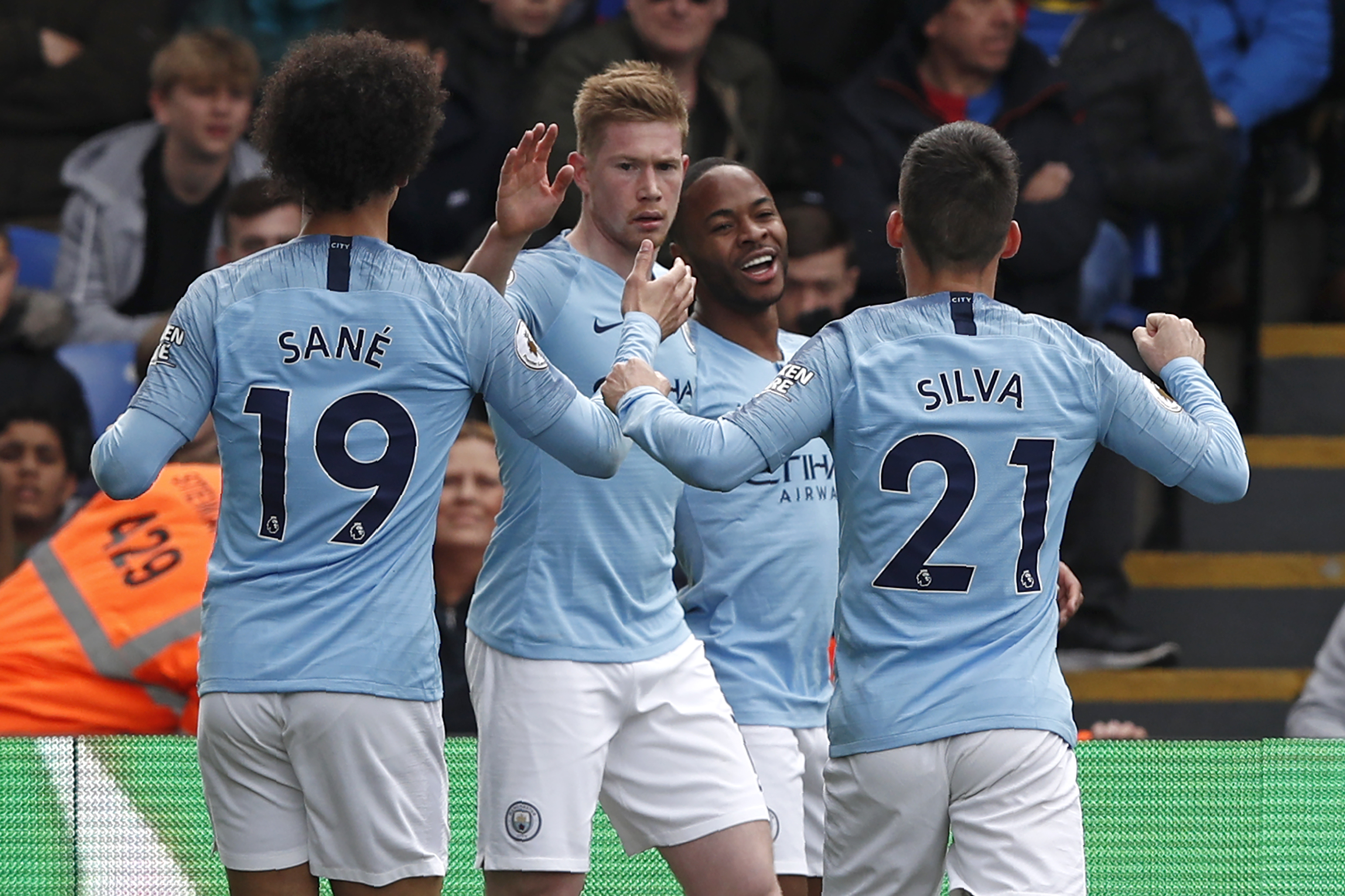 Manchester City's English midfielder Raheem Sterling (2nd R) celebrates with teammates after scoring the opening goal of the English Premier League football match between Crystal Palace and Manchester City at Selhurst Park in south London on April 14, 2019.