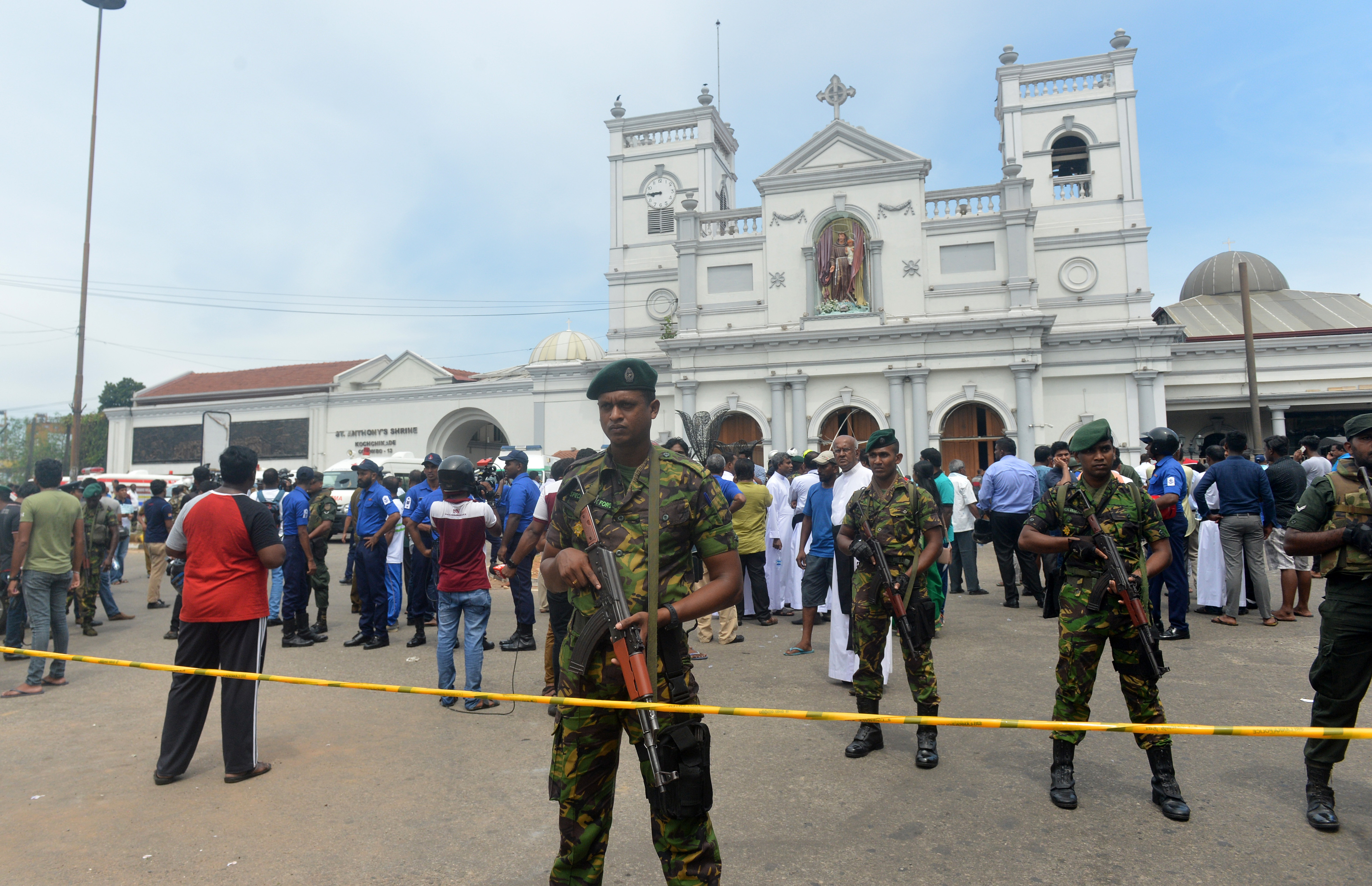 Sri Lankan security personnel keep watch outside the church premises following a blast at the St. Anthony's Shrine in Kochchikade, Colombo on April 21, 2019. Explosions have hit three churches and three hotels in and around the Sri Lankan capital of Colombo, police said on April 21.