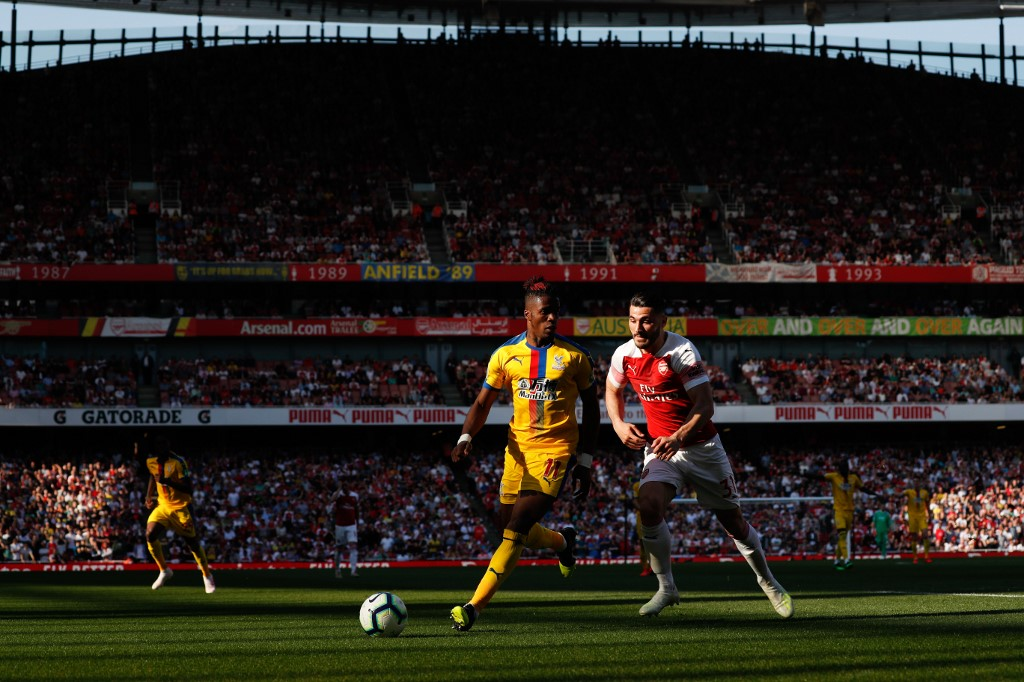 Arsenal's German-born Bosnian defender Sead Kolasinac (R) chases down Crystal Palace's Ivorian striker Wilfried Zaha (L)
