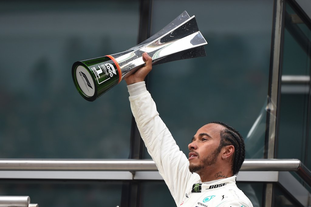 Mercedes' British driver Lewis Hamilton celebrates on the podium after winning the Formula One Chinese Grand Prix in Shanghai on April 14, 2019.