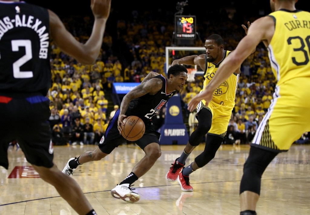 Lou Williams #23 of the LA Clippers drives on Kevin Durant #35 of the Golden State Warriors during Game Two of the first round of the 2019 NBA Western Conference Playoffs at ORACLE Arena.
